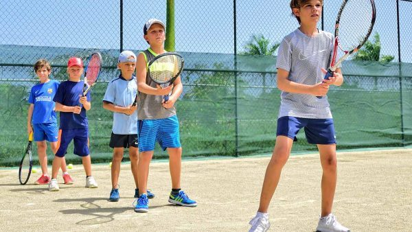 Tennis lessons for kids. Coaching and training with after school junior programs. Classes for youth, preschoolers 2,3,4,5,6,7,8 years old and older. First lesson for FREE at our club.